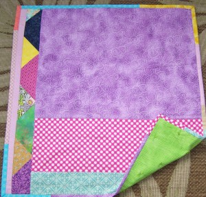 scrappy pieced quilt back